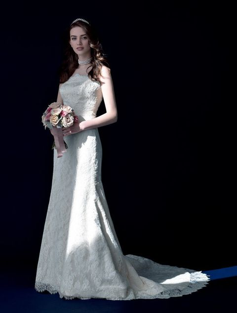 Gown, Wedding dress, Dress, Bride, Clothing, Fashion model, Bridal clothing, Bridal party dress, Photograph, Bridal accessory,