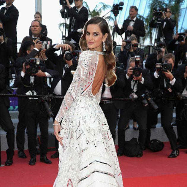 Gown, Fashion model, Dress, Red carpet, Carpet, Clothing, Flooring, Premiere, Fashion, Haute couture,