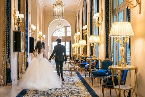 Photograph, Wedding dress, Bride, Dress, Blue, Gown, Bridal clothing, Yellow, Ceremony, Aisle,