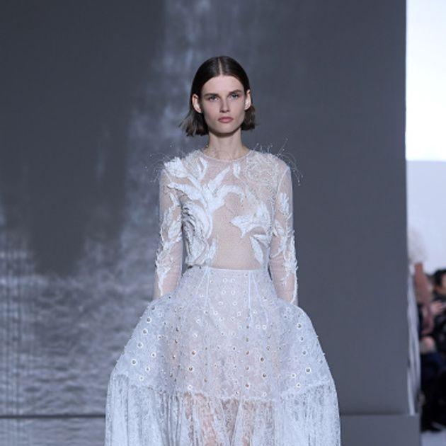 Fashion model, Fashion, Haute couture, Clothing, Dress, Gown, Fashion show, Wedding dress, Shoulder, Runway,