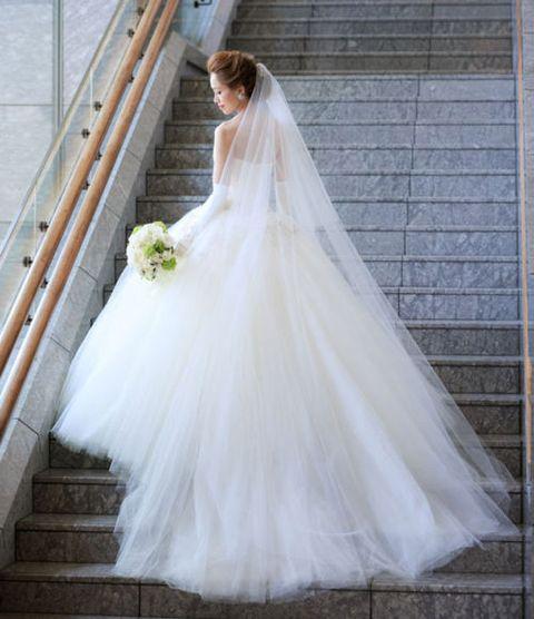 Wedding dress, Gown, Bride, Dress, Clothing, Bridal clothing, Bridal accessory, Photograph, Bridal party dress, Shoulder,
