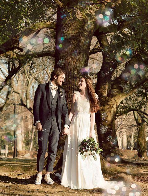 Photograph, Bride, Wedding dress, Dress, Tree, Gown, Ceremony, Wedding, Woodland, Formal wear,