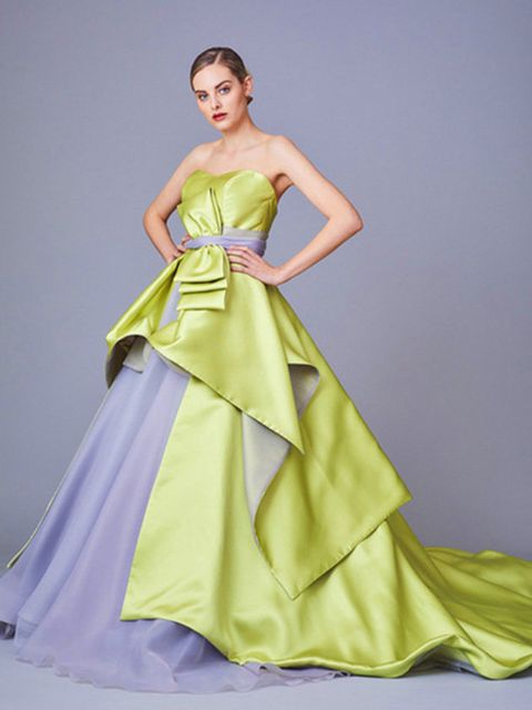 Clothing, Gown, Fashion model, Dress, Bridal party dress, Shoulder, Yellow, Formal wear, Strapless dress, Haute couture,