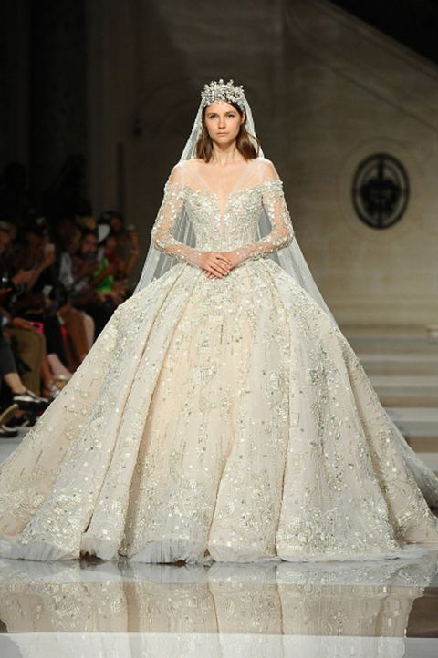 Wedding dress, Gown, Fashion model, Dress, Clothing, Fashion, Bridal clothing, Haute couture, Bridal accessory, Fashion show,