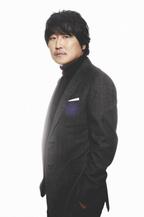 Clothing, Outerwear, Standing, Black hair, Neck, Jacket, Sleeve, Suit, Formal wear, Top,