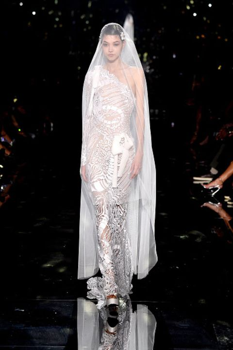 Fashion, Haute couture, Dress, Fashion model, Veil, Bridal accessory, Bridal veil, Outerwear, Event, Gown,