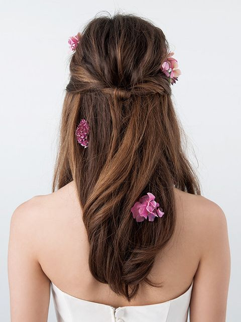 Hair, Brown, Hairstyle, Forehead, Shoulder, Petal, Hair accessory, Style, Long hair, Beauty,