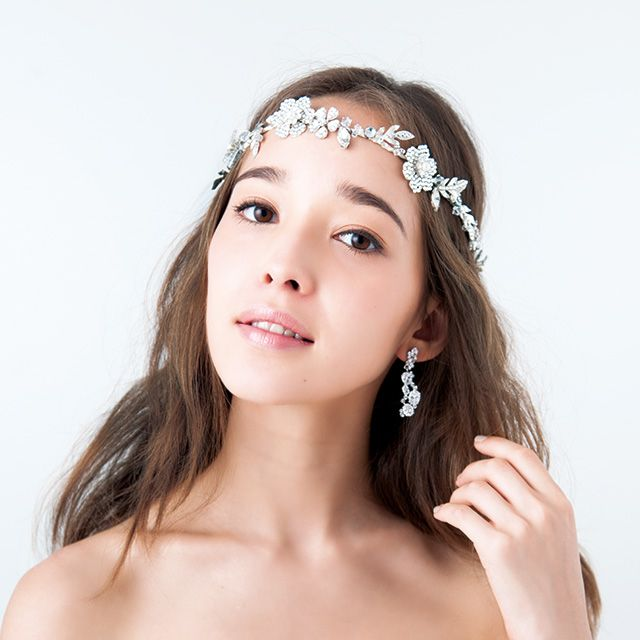 Clothing, Hair, Lip, Hairstyle, Skin, Forehead, Shoulder, Eyebrow, Hair accessory, Bridal accessory,