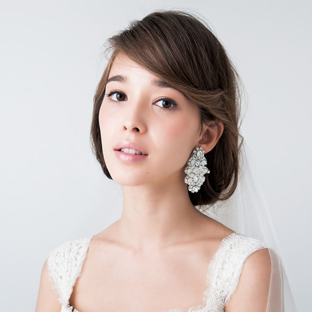 Clothing, Hairstyle, Skin, Shoulder, Eyebrow, Textile, Photograph, Joint, Bridal accessory, Earrings,