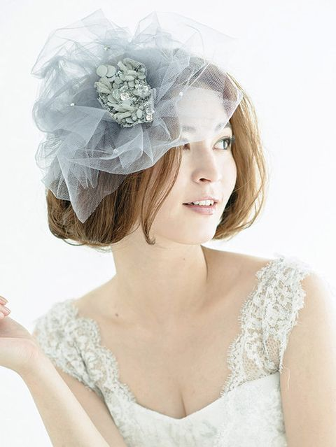 Clothing, Hairstyle, Skin, Shoulder, Bridal accessory, Hair accessory, Headpiece, Style, Headgear, Beauty,