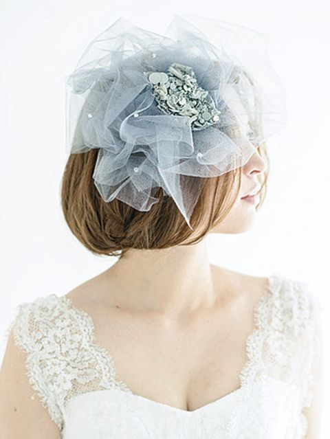 Clothing, Hairstyle, Shoulder, Bridal accessory, Hair accessory, Style, Headpiece, Headgear, Dress, Costume accessory,