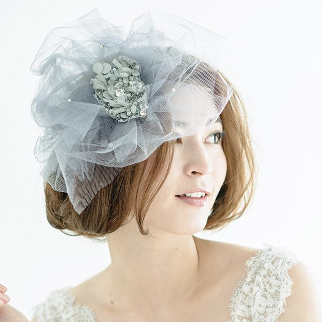 Clothing, Hairstyle, Skin, Shoulder, Bridal accessory, Headpiece, Hair accessory, Headgear, Beauty, Costume accessory,