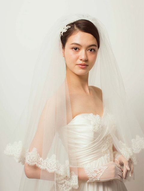 Clothing, Bridal veil, Bridal clothing, Veil, Skin, Sleeve, Shoulder, Bridal accessory, Textile, Photograph,