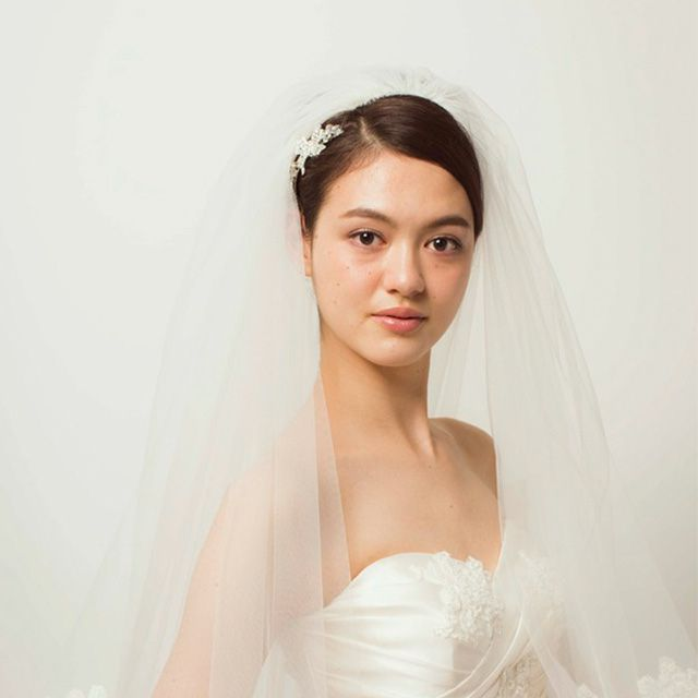 Clothing, Bridal veil, Bridal clothing, Veil, Skin, Sleeve, Bridal accessory, Shoulder, Textile, Photograph,