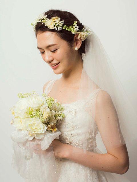 Clothing, Petal, Yellow, Skin, Shoulder, Bridal clothing, Textile, Bridal accessory, Photograph, Flower,