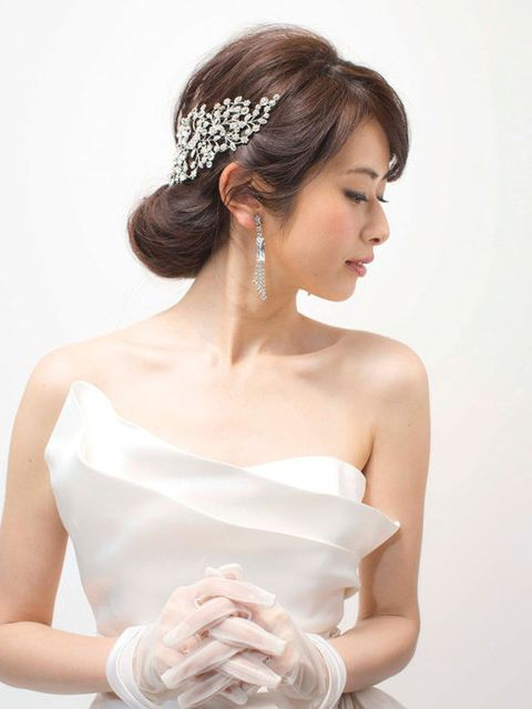 Clothing, Arm, Hairstyle, Skin, Shoulder, Bridal accessory, Hand, Joint, Bridal clothing, Dress,