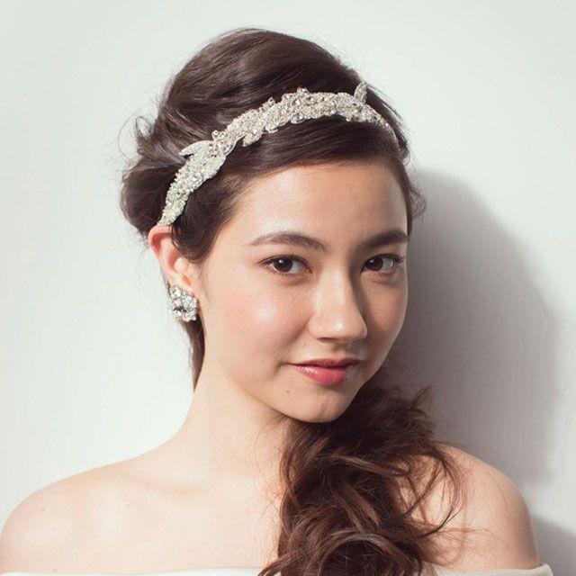 Clothing, Hair, Lip, Hairstyle, Skin, Forehead, Shoulder, Eyebrow, Bridal accessory, Hair accessory,