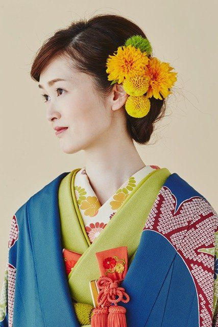Yellow, Hairstyle, Style, Art, Fashion, Costume, Costume design, Hair accessory, Tradition, Artificial flower,