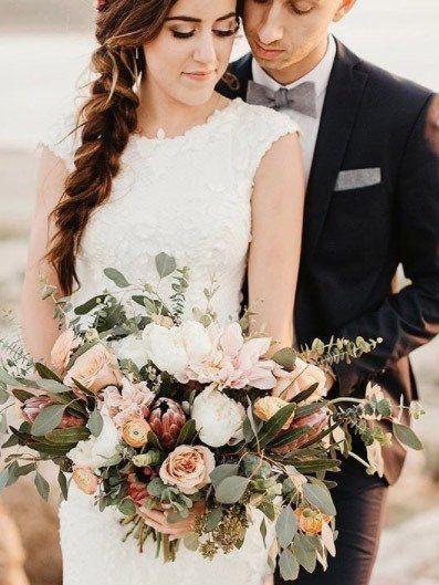 Wedding dress, Dress, Gown, Clothing, Flower Arranging, Formal wear, Bridal clothing, Floristry, Bride, Bouquet,