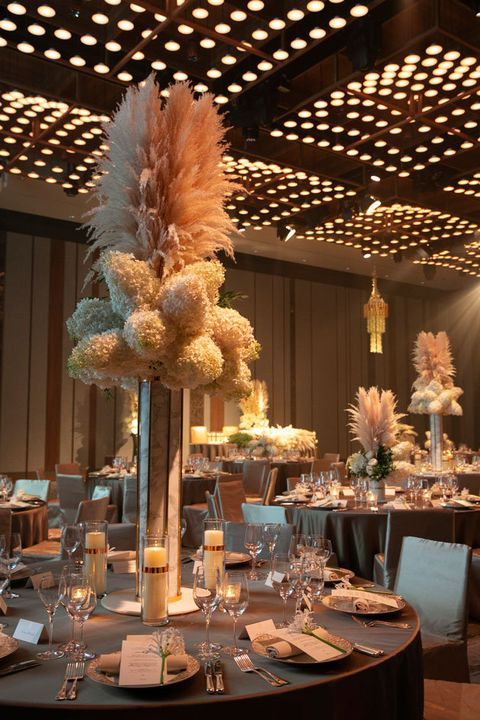 Centrepiece, Function hall, Rehearsal dinner, Feather, Tableware, Floral design, Table, Interior design, Decoration, Flower Arranging,