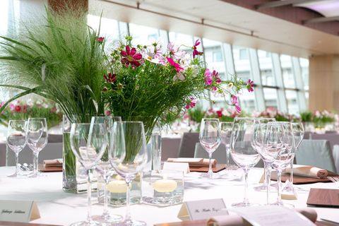 Wedding banquet, Centrepiece, Restaurant, Flower, Rehearsal dinner, Wine glass, Glass, Banquet, Table, Stemware,