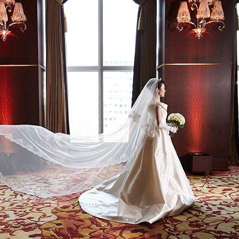 Floor, Dress, Flooring, Textile, Bridal clothing, Bridal veil, Veil, Gown, Wedding dress, Bride,