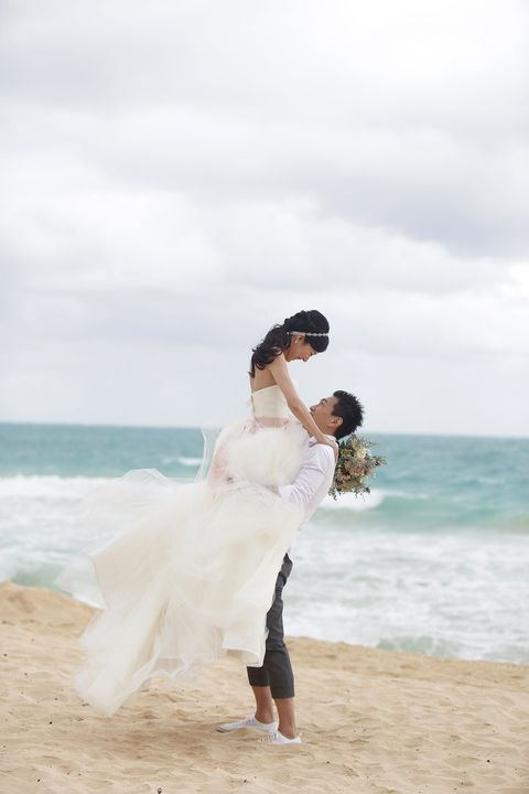 Body of water, People on beach, Coastal and oceanic landforms, Shoe, Dress, Photograph, Happy, Shore, Bridal clothing, Ocean,