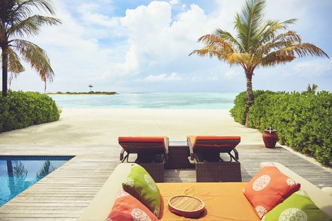 Resort, Property, Vacation, Caribbean, Palm tree, Tropics, Outdoor furniture, Ocean, Arecales, Tree,