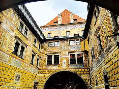 Architecture, Building, Yellow, Town, Landmark, Urban area, City, Arch, Brick, Facade,