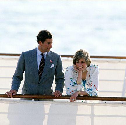 Coat, Suit, Tie, Conversation, White-collar worker, Outdoor furniture, Love, Ceremony,