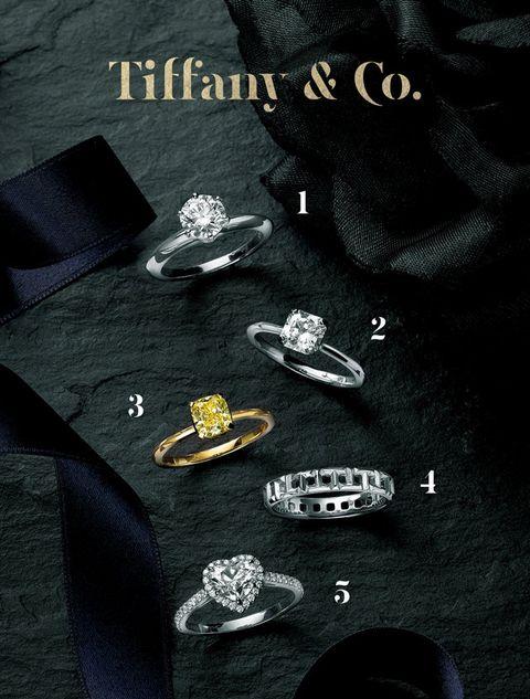 Black, Fashion accessory, Font, Brand, Diamond, Games, Metal, Jewellery,