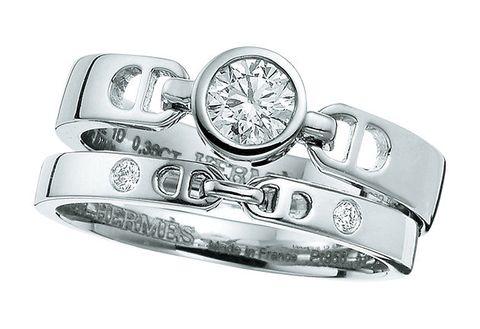 Ring, Platinum, Fashion accessory, Jewellery, Diamond, Engagement ring, Metal, Wedding ring, Wedding ceremony supply, Pre-engagement ring,
