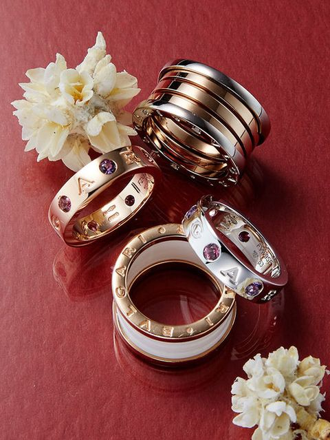 Petal, Still life photography, Jewellery, Metal, Cut flowers, Wedding ceremony supply, Silver, Circle, Artificial flower, Ring,