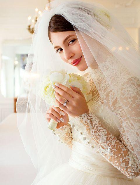 Clothing, Bridal veil, Veil, Bridal clothing, Finger, Skin, Sleeve, Wedding dress, Bride, Bridal accessory,
