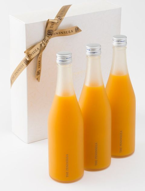 Yellow, Bottle, Glass bottle, Juice, Orange juice, Drink, Orange soft drink, Mimosa, Orange drink,