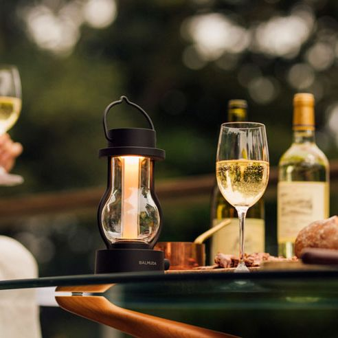 Drink, Alcoholic beverage, Wine, Wine bottle, Wine glass, Bottle, Glass, Table, Stemware, Glass bottle,