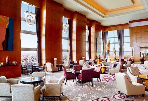 Interior design, Room, Furniture, Table, Ceiling, Orange, Interior design, Couch, Restaurant, Living room,