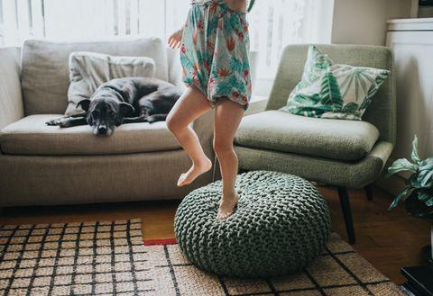 Green, Furniture, Bean bag, Couch, Floor, Room, Living room, Plant, Flooring, Interior design,