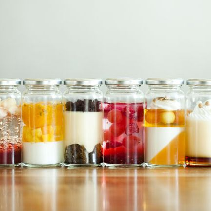 Mason jar, Candy corn, Food, Drink, Glass bottle, Glass, Candle, Food storage containers, Drinkware,