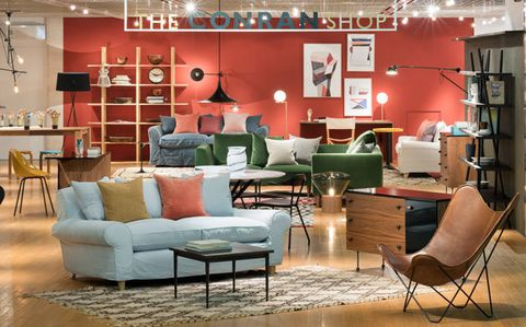 Living room, Furniture, Room, Interior design, Couch, Building, Wall, Table, Floor, Coffee table,