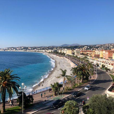 Sky, Coast, Beach, Sea, Palm tree, Town, Tree, Shore, Tourism, Urban area,