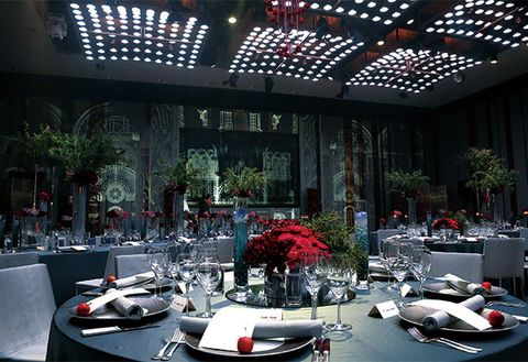 Red, Luxury vehicle, Building, Architecture, Interior design, Restaurant, Design, Room, Table, Ceiling,