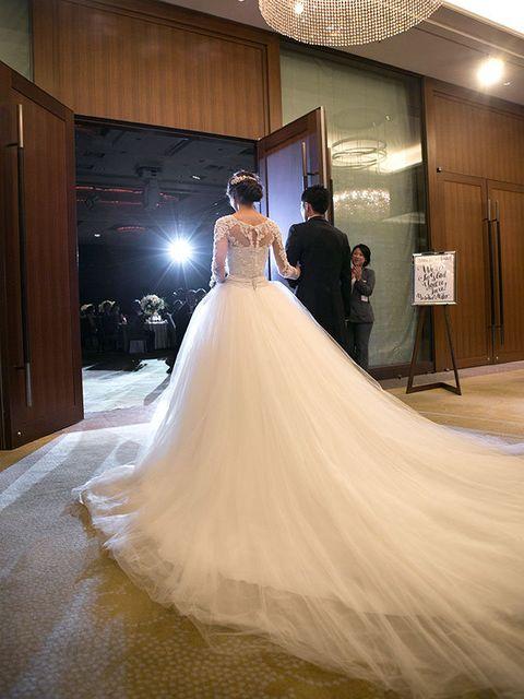 Gown, Wedding dress, Dress, Bride, Bridal clothing, Photograph, Clothing, Bridal party dress, Shoulder, Bridal accessory,