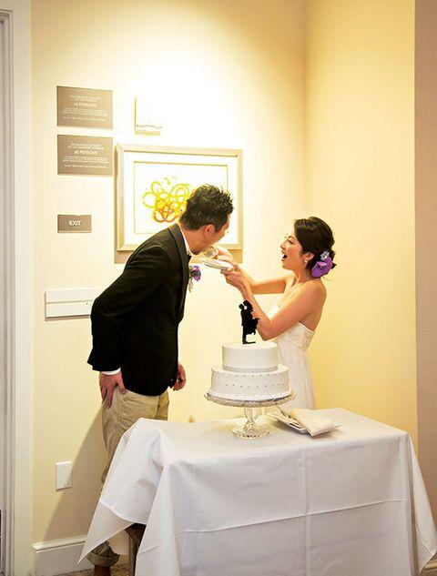 Tablecloth, Cake, Trousers, Dessert, Bridal clothing, Dress, Baked goods, Outerwear, Wedding dress, Coat,