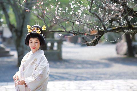 Branch, Twig, Street fashion, Headpiece, Hair accessory, Costume, Kimono, Fur, Tradition, Portrait photography,
