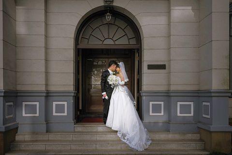 Clothing, Dress, Bridal clothing, Trousers, Coat, Photograph, Suit, Gown, Bride, Wedding dress,