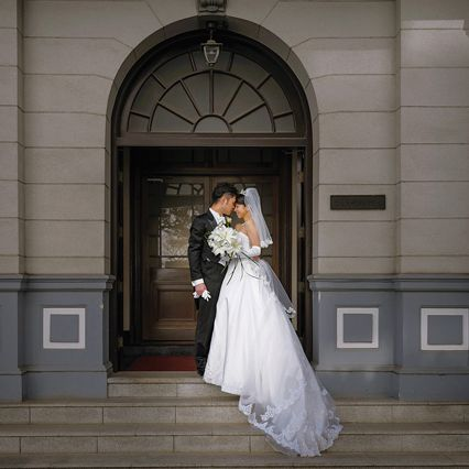 Clothing, Dress, Bridal clothing, Trousers, Coat, Photograph, Suit, Gown, Bride, Formal wear,