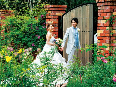 Dress, People in nature, Door, Garden, Wedding dress, Shrub, Bridal clothing, Gown, Bride, Brick,