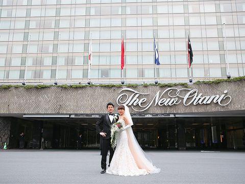 Bridal clothing, Dress, Trousers, Coat, Outerwear, Gown, Suit, Bride, Wedding dress, Formal wear,