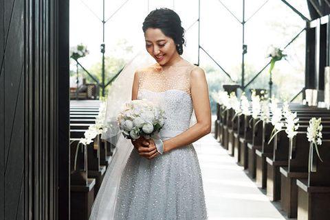 Clothing, Dress, Eye, Trousers, Human body, Bridal clothing, Shoulder, Petal, Photograph, Bouquet,